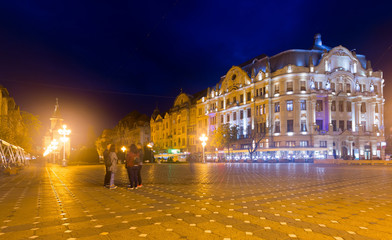 Foto op Plexiglas Brussel Lighted Victoriei Square and Orthodox Cathedral, Timisoara
