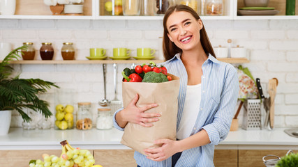 Young Woman Holding Paper Bag With Vegetables And Fruits