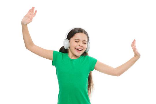 Play any song. Try premium account. Enjoy nonstop music. Privilege of premium music account. Little girl listen music modern headphones. Small kid listen music headphones. No ad interruptions