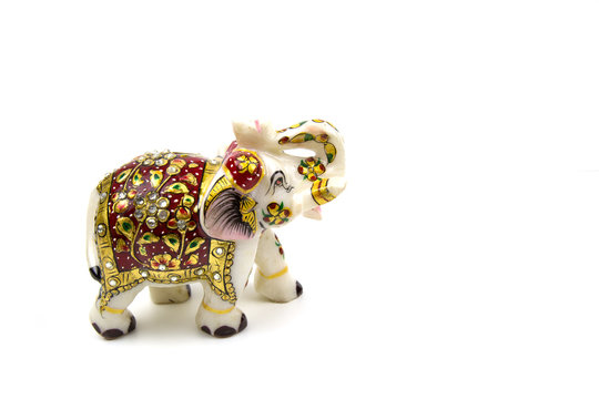 White elephant marble figurine with red and gold painting isolated on white background Traditional Indian souvenir Idea design concept with copy space add text