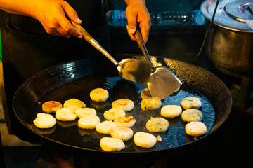 Vegan Dim Sum fried in a Thai Pan, Street food on Phuket Island during the Vegetarian Festival in Thailand, Asia