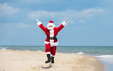 Christmas Santa Claus on the beach. New Year's travel vacation discounts and travel agencies price reductions concept.