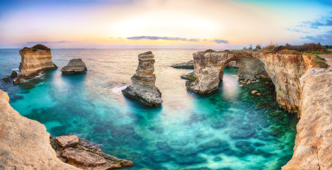 Dramatic seascape with cliffs, rocky arch at Torre Sant Andrea