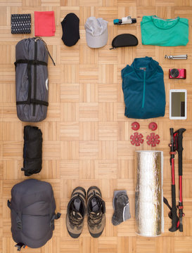Top view and flat lay of men's camping gear and equipment, with copy space for text