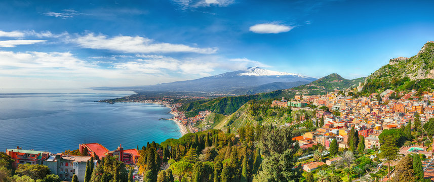 Aquamarine blue waters of sea near Taormina resorts and Etna volcano mount