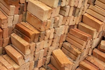 pile of bricks which is prepared for construction. red brick wall at the construction site.