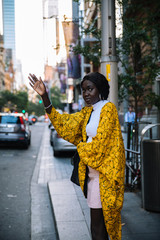 Woman waving for a taxi