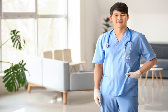 Male medical assistant in clinic