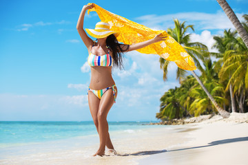 Free happy woman enjoying tropical Caribbean island Saona, Dominican Republic. Summer vacation and healthy living concept