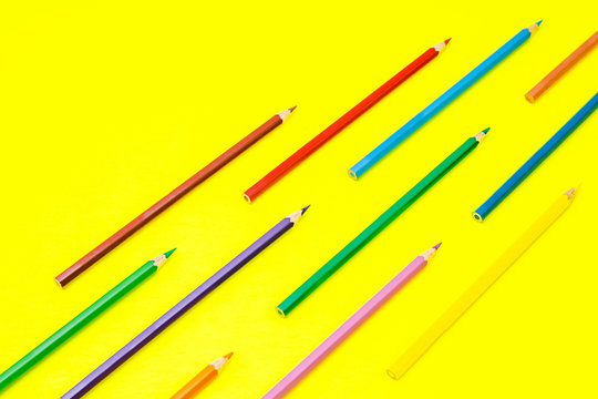 Pencils on yellow background, school stationery