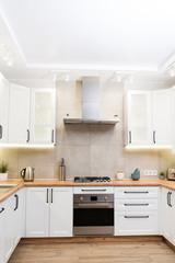Stylish white scandinavian kitchen interior with decor accessories
