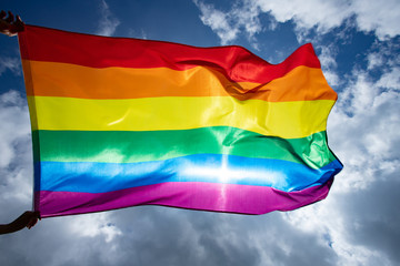 Colorful LGBT flag blows in the breez.