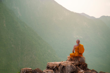 Buddha monk practice meditation on mountain Wall mural