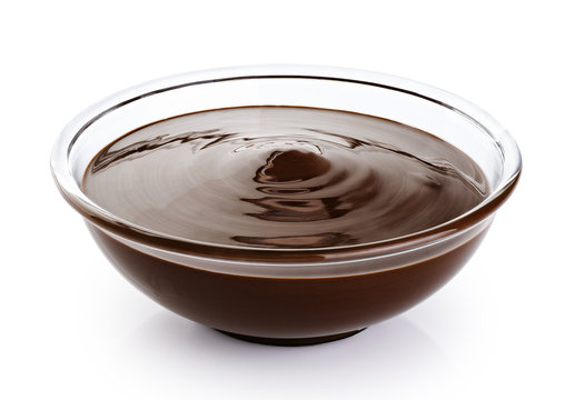 Bowl with melted chocolate isolated on white background.