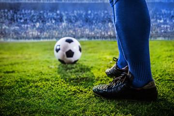 feet of soccer blue team in the stadium