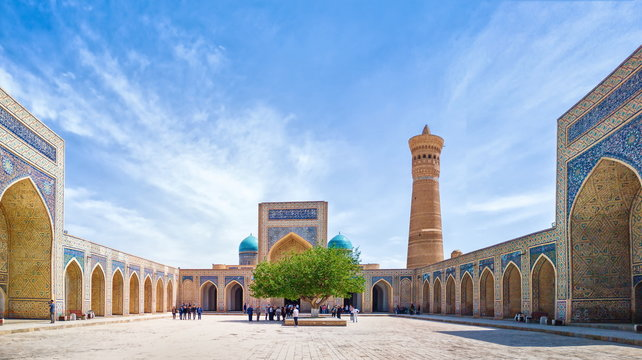 Panoramic view of Poi Kalan - an islamic religious complex located around the Kalan minaret in Bukhara, Uzbekistan
