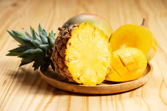 fresh pineapple and mangoes