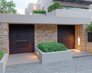 modern house double entrance wooden doors late in the evening