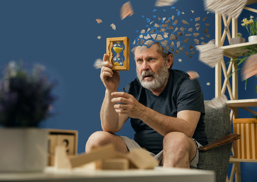 Drown image of losing of mind. Old bearded man with alzheimer desease has problems with his hands motor skills. Illness, memory loss due to dementia, healthcare, neurological disorder, depression.