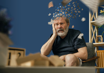 Drown image of losing of mind. Old bearded man with alzheimer desease sitting and suffering from headache. Illness, memory loss due to dementia, healthcare, neurological disorder, depression. Wall mural