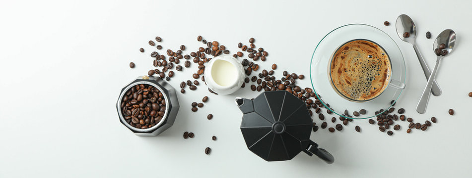 Flat lay composition with coffee time accessories on white background, space for text and top view