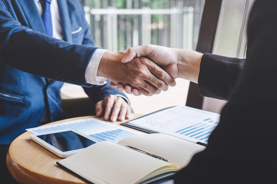 Handshake of two business people after contract agreement become a partner