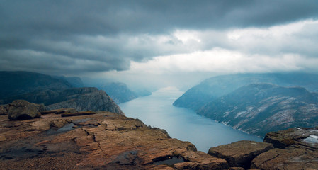 Foggy landscape of rocky mountains and Lysefjord in Preikestolen, Stavanger, Norway. Panorama