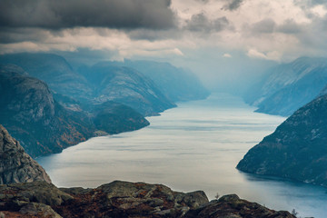 Mystic and foggy landscape of rocky mountains and fjord in Preikestolen, Stavanger, Norway. Top view