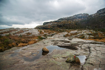 Cloudy, foggy day in Preikestolen, Norway. Beautiful landscape of rocky mountains after the rain