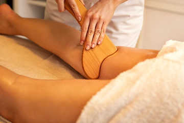 Anti-cellulite Madero Therapy massage done with specially designed wooden tool