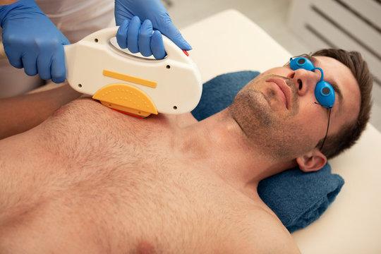 Laser epilation treatment to man chest