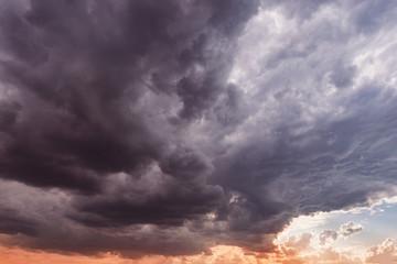 Dark storm clouds before rain at sunset.
