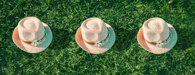 Summer background Pink sunhat on green grass. Top View. Pop art design, creative summer party concept. Minimalism.