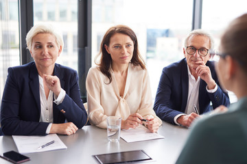 Business people having a conversation at conference table