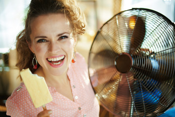woman with ice cream in modern house in sunny hot summer day