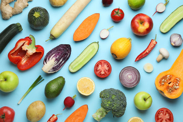 Flat lay composition with fresh ripe vegetables and fruits on color background