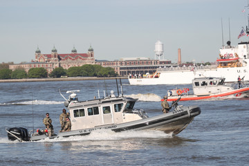 U.S. Coast Guard vessels patrol the New York Harbor marking the beginning of Fleet Week in New York