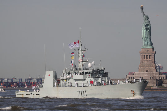 The HMCS Glace Bay Canadian Navy coastal defense vessel makes way past the Statue of Liberty in New York Harbor marking the beginning of Fleet Week  in New York