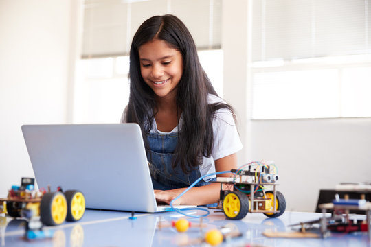Female Student Building And Programing Robot Vehicle In After School Computer Coding Class