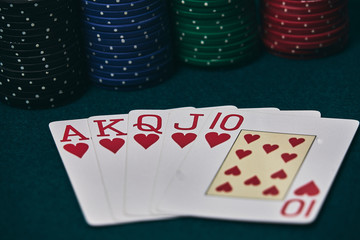 Poker Hands / Royal Flush 3. Five playing cards - the poker royal flush hand. Royal Flash,red card deck, poker royal flash on cards and poker chips on green casino table. success in gambling.