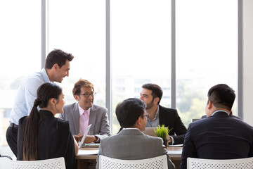 Chief businessman standing at conference table during team meeting, Entrepreneurs making deal starting collaboration at group negotiations teamwork