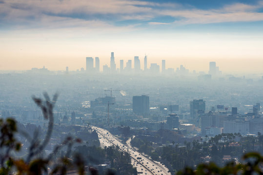 LOS ANGELES, CALIFORNIA - FEB 13: Sunrise towards a smog ridden Los Angeles downtown.  LA is well known for its Hollywood film district.