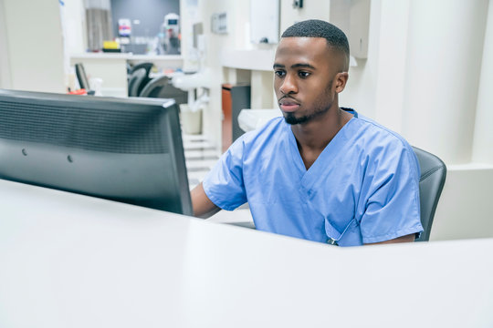 Nurse using computer in hospital