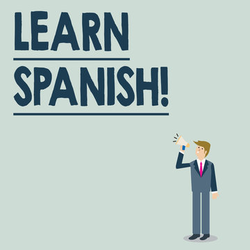 Conceptual hand writing showing Learn Spanish. Concept meaning gain or acquire knowledge of speaking and writing Spanish Businessman Looking Up, Holding and Talking on Megaphone