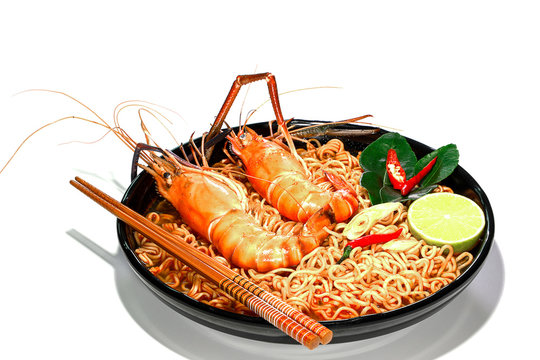 Spicy instant noodles soup with rivers shrimp on top, isolated on white background. Tom Yum Kung name in Thailand Foods Style.