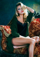 young blond woman in fairy luxury interior with  antique chair total wealth, rich lifestyle concept close up