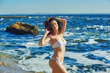 Young woman in a swimsuit on the beach