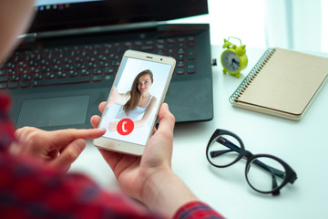 Woman chatting online with friends through a video connection and video calls