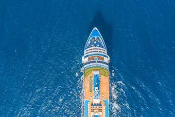 Nose of the cruise ship in the turquoise sea. Concept of summer sea cruise tours.