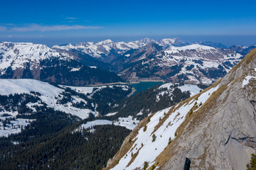 Mountains in Switzerland, with view on the arch dams Hongrin